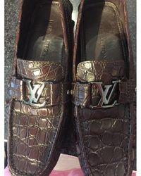 Louis Vuitton Mocassins crocodile marron
