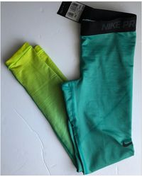 Nike - Pantalon de fitness polyester vert - Lyst