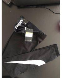 Nike - Pantalon de fitness coton noir - Lyst