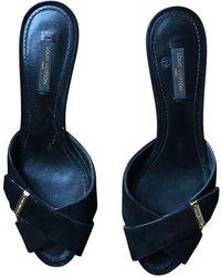Louis Vuitton Mules cuir noir