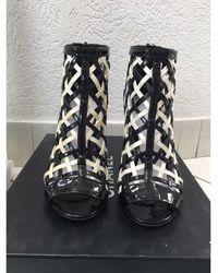 Chanel Bottines & low boots à talons cuir verni noir