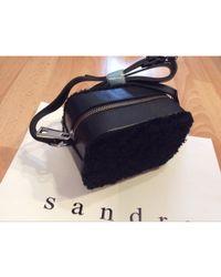 Sandro Sac pochette en cuir cuir noir