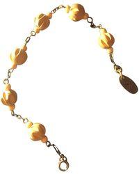 Étoile Isabel Marant - Bracelet bois jaune - Lyst