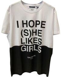 Balmain - Top, tee-shirt coton blanc - Lyst