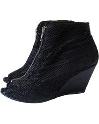 Sandro Bottines & low boots à compensés cuir noir