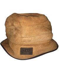 UGG - Bonnet cuir / laine beige - Lyst