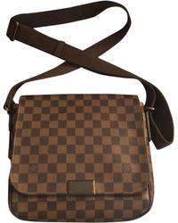 Louis Vuitton Sac en bandoulière cuir marron