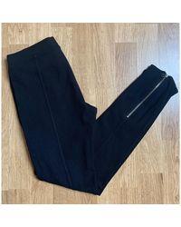 Sandro - Pantalon de fitness viscose noir - Lyst