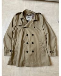 Burberry - Imperméable, trench polyester beige - Lyst