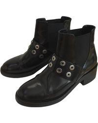 Sandro Bottines & low boots plates cuir noir
