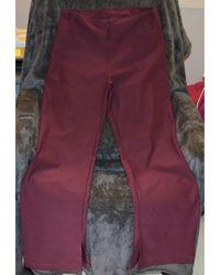 Nike - Pantalon de fitness polyester rouge - Lyst