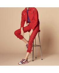 Sandro - Jeans slim coton rouge - Lyst