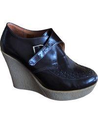 Sandro Bottines & low boots à compensés cuir marron