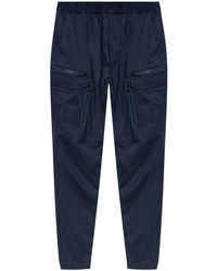 White Mountaineering Trousers With Pockets - Blue