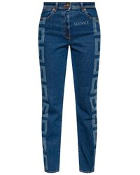 Versace - Jeans With Logo Blue - Lyst