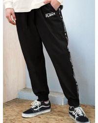 F.ILLUMINATE [unisex] Black Taping Track Pants-black