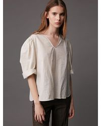 AEER Curved Balloon Buttoned Back Blouse - Natural