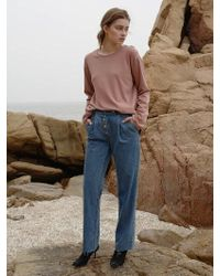 among - A Tuck Button Jean - Lyst