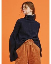 ANOTHER A - Trumpet Sleeve Turtleneck Knit Top (navy) - Lyst