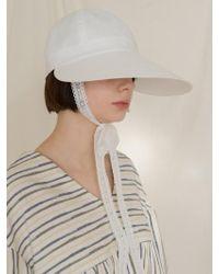 among A Pauline Hat White