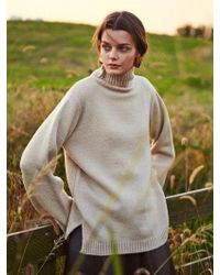 YAN13 - Turtle Neck Slit Knit Beige - Lyst