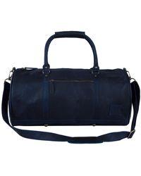 MAHI - Leather Weekend Classic Duffle Bag In Navy - Lyst