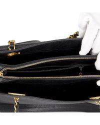 b265e6f0401839 Chanel Caviar Leather Cc Chain Wallet Black A48654 in Black - Lyst
