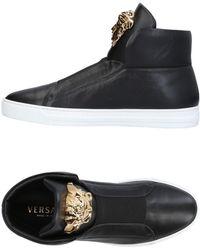 Versace - Sneakers abotinadas - Lyst