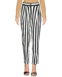 THINK BELIEVE - Casual Trousers - Lyst