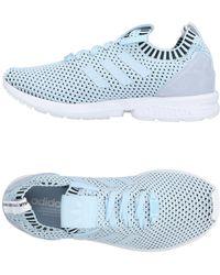 Lyst Adidas Originals 10% Camisetas bajas y para zapatillas 658 de deporte blancas para hombre Ahorre 10% b246ba2 - rspr.host