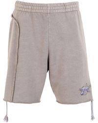 Reebok Shorts e bermuda - Grigio