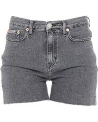 a9423bbc35 Shorts Calvin Klein de mujer desde 20 € - Lyst