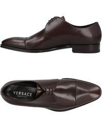 Versace Zapatos de cordones - Marrón