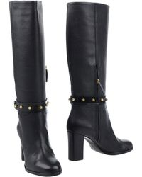 87bd3f3ba4b Lyst - Women s Boutique Moschino Knee boots On Sale