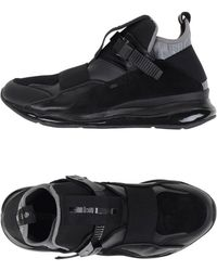 Alexander Mcqueen X Puma High Top leather Sneakers in Black