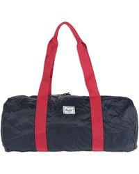Herschel Supply Co. Travel Duffel Bags - Red