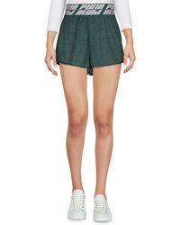 PUMA Shorts - Grün