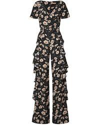 Michael Kors Combi-pantalon En Crêpe De Chine De Soie À Imprimé Fleuri, À Volants Et À Ceinture - Noir