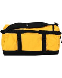 The North Face Duffel Bags - Yellow