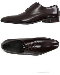 Versace Chaussures à lacets - Marron