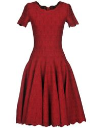Alaïa - Short Dresses - Lyst