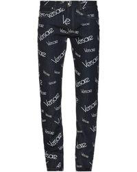 Versace - Pantalones vaqueros - Lyst