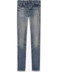 Saint Laurent Mid-rise skinny jeans in fADED BLUE DENIM - Blau