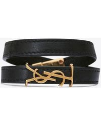 Saint Laurent OPYUM double wrap bracelet in leather and gold-toned metal - Nero