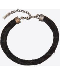 Saint Laurent Bracelet torque en plumes et métal - Noir
