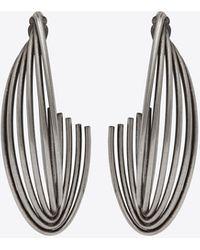 Saint Laurent Twisted hoop earrings in metal - Metallizzato