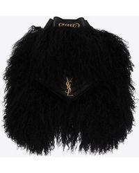 Saint Laurent Joe sac à dos en shearling et cuir d'agneau - Noir