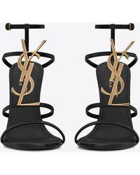 Saint Laurent Cassandra sandales en cuir verni et monogramme noir