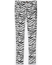 Saint Laurent Skinny jeans in black and white zebra-print stretch denim - Nero