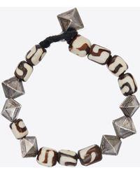 Saint Laurent Marrakech bracelet de perles et de coquillages en résine et métal - Marron